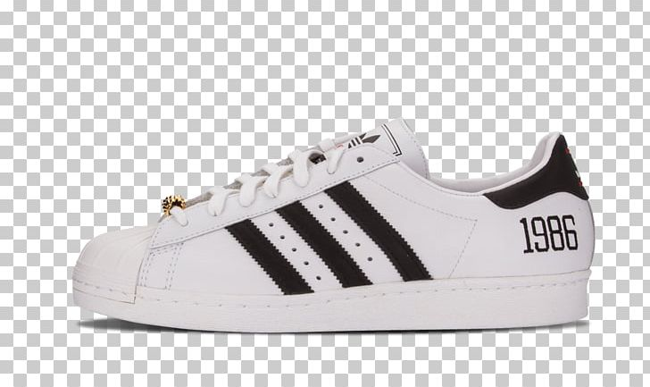 Unpaired white and black adidas superstar shoe with box